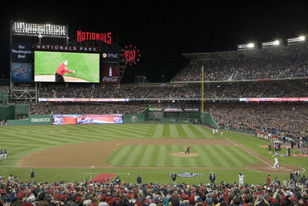 President George W. Bush throws the ceremonial first pitch before a sold out crowd at the Washington Nationals' season opener on March 30, 2008 Bush Nationals season open.jpg
