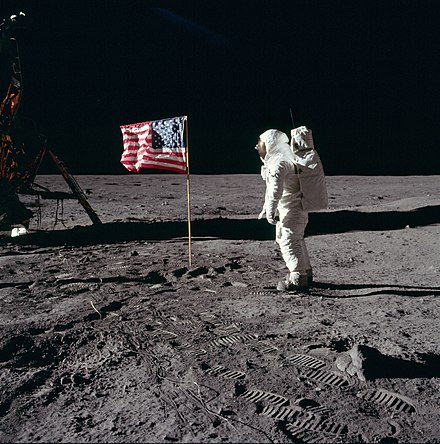Apollo 11 astronaut Buzz Aldrin, Apollo Lunar Module pilot of the first crewed mission to land on the Moon, poses for a photograph beside the deployed United States flag during his Extravehicular Activity (EVA) on the lunar surface. Buzz salutes the U.S. Flag.jpg