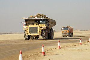 Caterpillar 777 - A Caterpillar 777D followed by a conventionally sized dump truck