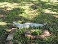 Cemetery Gator - presumably the remains of a grave-marker. Cedar Hill Cemetery, Vicksburg, Mississippi.jpg