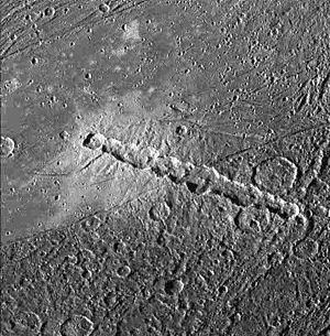 Crater chain - Enki Catena is a chain of impact craters on Ganymede, caused by a fragmented space body (probably a comet). The picture covers an area about 120 miles wide.