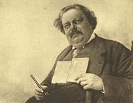 Chesterton Holding Book and Pen.jpg
