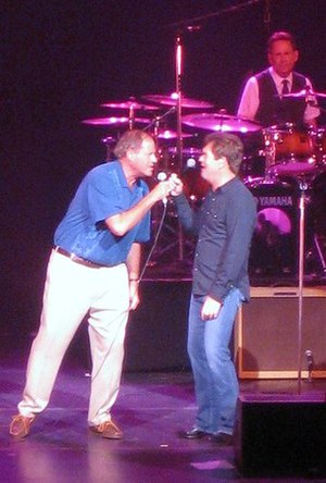 "Chris Berman - Berman sings ""Walking on a Thin Line"" with Huey Lewis and the News on stage"