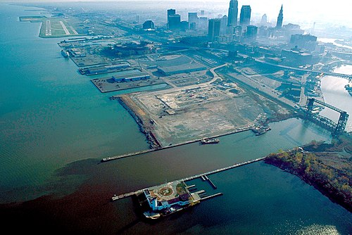 1992 aerial view of the Cleveland harbor, with the mouth of the Cuyahoga River in the foreground (view towards the east). Cleveland Ohio aerial view.jpg