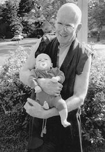 Colin Turnbull. (Lobsang Ridgol) holding a friend's baby, Gainesville, Florida, 1993.jpg