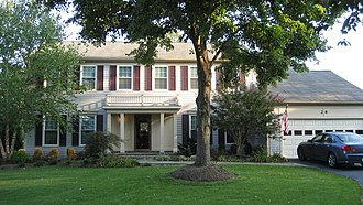 """CountrySide, Virginia - A typical colonial-style single-family home in the CountrySide subdivision in Sterling, Virginia. This model, known as the """"Williamsburg,"""" was built by Pulte Homes in 1984 and has five bedrooms and 3.5 baths and is valued at approximately $505,000."""