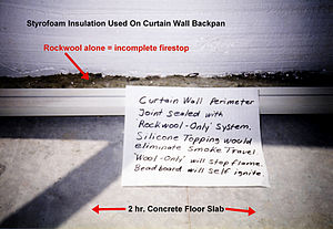 Joint (building) - Combustible Polystyrene insulation in point contact with sheet metal curtain wall backban. Incomplete firestop made of rockwool without topcaulking.
