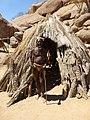 Damara man infront of a traditional Damara hut.jpg