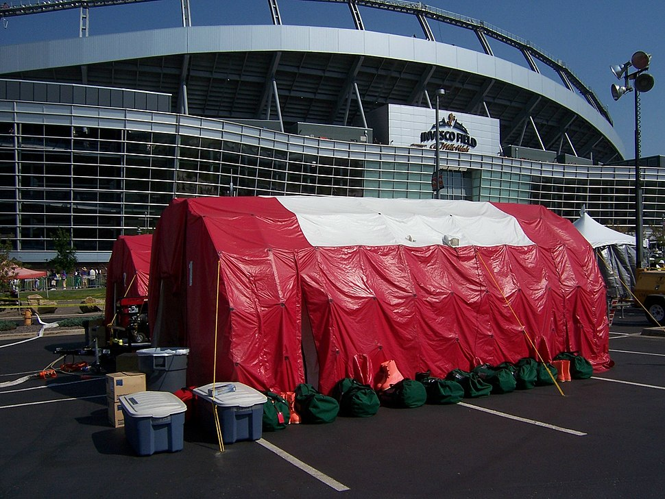 Decontamination tents in front of INVESCO Field