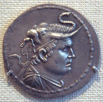 Silver coin depicting Demetrius I of Bactria (reigned c. 200-180 BC), wearing an elephant scalp, symbol of his conquests of areas in the northwest of South Asia, where Afghanistan and Pakistan are today. DemetriusIMet.jpg