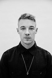 Greyscale image of Diplo looking to the camera.