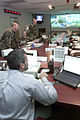 Disaster Control Group (DCG) acting commander, Civilian Adam Buehler of the 305 Civil Engineer Squadron, McGuire Air Force Base, New Jersey monitors the DCG and talks with squadron representatives from the 010911-F-KF493-002.jpg