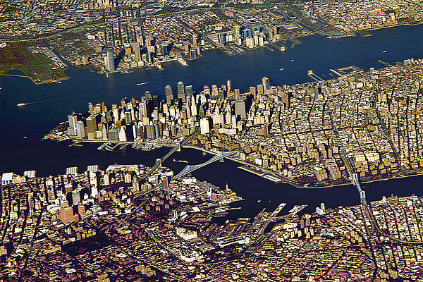 Ports play an important role in facilitating international trade. The Port of New York and New Jersey grew from the original harbor at the convergence of the Hudson River and the East River at the Upper New York Bay. Downtown Manhattan From Aeroplane.jpg