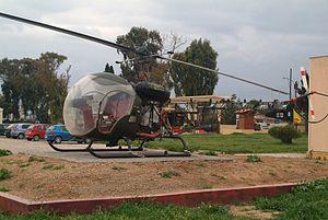 ES 722 Bell OH-13H preserved on the gate at Megara..jpg