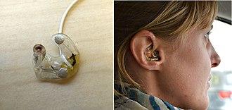 Ear-EEG - Examples of in-ear EEG mounts. On the left is seen a single earplug (right ear), on the right is seen a right earplug in ear.