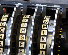 https://upload.wikimedia.org/wikipedia/commons/thumb/d/dd/Enigma_rotors_with_alphabet_rings.jpg/220px-Enigma_rotors_with_alphabet_rings.jpg