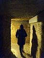 Entering into the Paris catacombs (9132136286).jpg