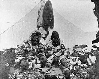Mukluk - Making mukluks, right (left, drilling ivory), ca. 1900, Port Clarence, Alaska