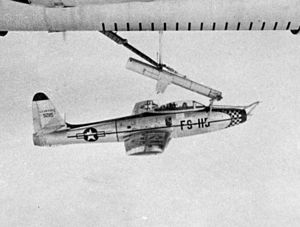 Parasite aircraft - An F-84 Thunderjet hooked on a FICON trapeze beneath its mother ship