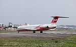 Far Eastern Air Transport MD-82 B-28035 Turning at Taipei Songshan Airport Runway 20150221.jpg