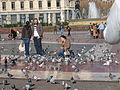 Feeding pigeons, Barcelona.JPG
