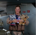 Female F-16 pilot Lt Col Rebecca Ohm (Operation Iraqi Freedom 2005) holds flags and stuffed animals flew with her.png