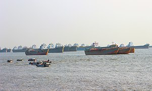 Fishing trawlers are waiting far from the Patenga sea beach for port of Chittagong.jpg