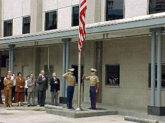 Wesley Clark - U.S. Marines at the United States consulate-general in Hong Kong lower the American flag out of respect for the 1999 Chinese embassy bombing victims.