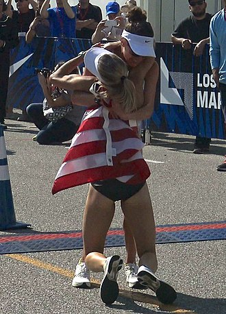 Shalane Flanagan - Shalane Flanagan collapses into Amy Cragg's arms while celebrating after the 2016 U.S. Olympic Trials Marathon
