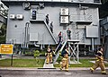 Flickr - Official U.S. Navy Imagery - U.S. Sailors, Coast Guardsmen and Royal Malaysian sailors exit the wet trainer simulator..jpg