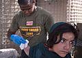 Florida corpsman treats Helmand youth 110515-M-ED643-005.jpg