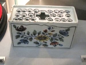 Flower brick - An English delftware flower brick, made in Liverpool; Walker Art Gallery