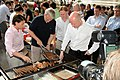 Foreign Secretary helping at the barbecue (5369151185).jpg