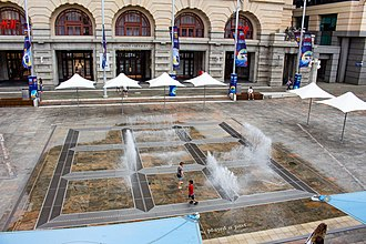 Forrest Place - Children playing in the Water Labyrinth interactive sculpture by artist Jeppe Hein