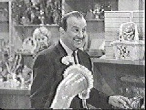 "Frank Nelson (actor) - Frank Nelson in The Jack Benny Program episode, ""Jack Does His Christmas Shopping"" (1954)"
