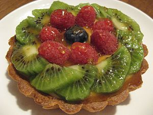 Fruit tart with kiwifruit and raspberries