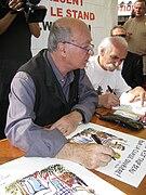 G. Wolinski dédicaçant à la fête de l'Huma 2007-01.jpg