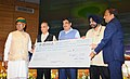 Ganga Rejuvenation, Shri Nitin Gadkari receiving the dividend cheque from the CMD of WAPCOS Ltd., Shri R.K. Gupta, at a function, in New Delhi.jpg