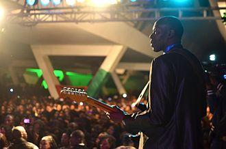 Gig (music) - Jimi Mbaye performing live.