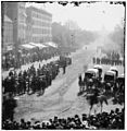 Group of ambulances followed by band and infantry units.jpg