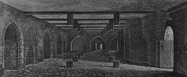 The undercroft beneath the House of Lords, as illustrated in 1799. At about the same time it was described as 77 feet long, 24 feet and 4 inches wide, and 10 feet high. Gunpowder plot parliament cellar.jpg