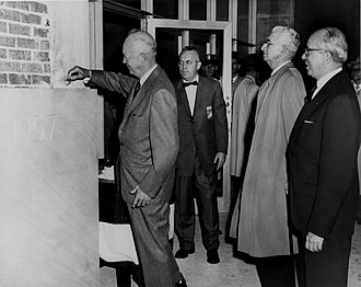 1958 US–UK Mutual Defence Agreement - Eisenhower (left) lays the cornerstone for the new Atomic Energy Commission (AEC) building in Germantown, Maryland, on 8 November 1957. Joint Committee on Atomic Energy (JCAE) Chairman Carl T. Durham (centre) and AEC Chairman Lewis Strauss (right) look on.