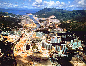 Tai Wai - View of Sha Tin New Town under development in 1983, looking northeast toward the Shing Mun River and Tolo Harbour. Tai Wai is in the foreground.