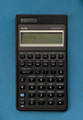 HP 27S Scientific calculator, front, power on, end of keyboard test, on blue background (30268535976).png