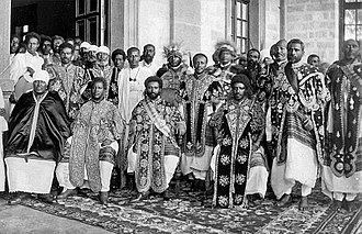 Emperor Haile Selassie I of Ethiopia (center) and members of the imperial court Haile Selassie and group.jpg