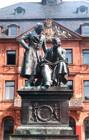 Grimms' Fairy Tales - Monument to brothers Grimm on the market place in Hanau. (Hessen, Germany)