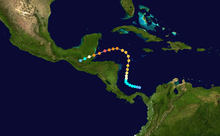 The path of a tropical cyclone, as represented by colored dots, denoting the storm's intensity and position at six hour intervals. Starting slightly right of center, the track moves up, before turning left and then to the bottom-left corner of the map.