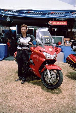 Fire and Rescue Department of Malaysia - A visitor posing with JBPM RIM's Honda ST 1300cc during a carnival