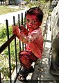 Holi celebrating by a little kid.jpg