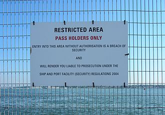 International Ship and Port Facility Security Code - ISPS Code being applied in Southampton, England, with signs prohibiting access to areas next to ships.